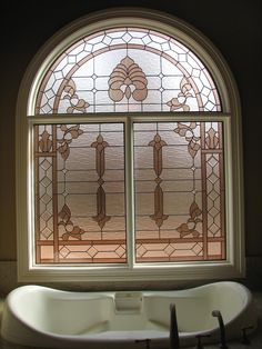 Love the mix of old with new and how the antique-inspired stained glass balances the contemporary design elements.