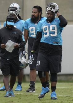 Carolina Panthers' Kawann Short (99) and Star Lotulelei (98) take a break during practice at the team's practice facility on Thursday, September 24, 2015.