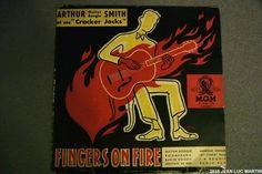 SMITH AND THE CRACKER JACKS: FINGERS ON FIRE MGM 103Le graphisme de la pochette fort r�ussi est du dessinateur M. PINEAU. Sur ce disque, ARTHUR SMITH joue entre jazz et classique et nous subjugue par son talent � la guitare.
