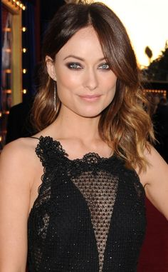 Olivia Wilde's smoldering smokey eyes and soft ombre waves.