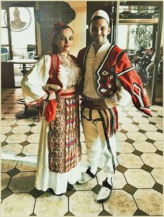 Traditional festive costumes from Albania.  Clothing style: early 20th century.  These are recent workshop-made copies, as worn by folk dance groups.
