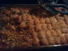 Tater Tot Casserole:  *1 lb. ground beef, cooked and drained  *1 can Mexicorn, drained  *1 can Rotel, drained  *1 can Ranch Style beans  *1 can Nacho Fiesta Campbell's soup  *Cheddar Cheese, shredded  *Frozen Tater tots    Mix beef and all canned ingredients together, put in Casserole dish. Top with cheese. Top with Tots. Bake as directed until tots are golden brown. Enjoy!