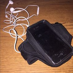 iPhone 4 exercise phone case Adjustable strap, and very steady even while running. Never used. Bags