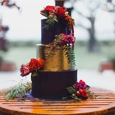 Repost via the talented crew at @harper_n_co of a purple and gold 3 tier round wedding cake at @stonesoftheyarravalley.... Fresh blooms by @sugarbeeflowers