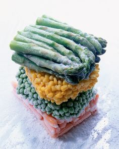 High-Res Stock Photography: Stack of frozen vegetables asparagus corn peas…