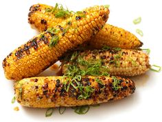 Grilled corn with soy sauce, butter, lemon, and a garlic-ginger blend.