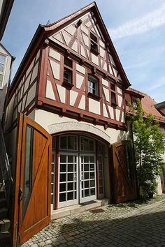 Ulm, Germany Carriage entrance converted.  Why can't more garage fronts look like this?