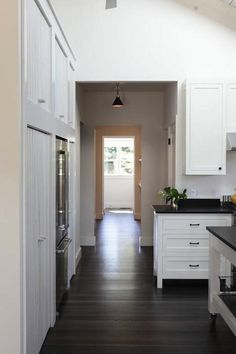Simply designing a cabinet to extend beyond a wall to create entry in small spaces.