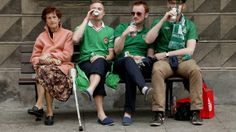 Republic of Ireland fans - and one local - drink on a bench in Gdansk at Euro 2012.