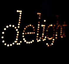 """Maya Lee's Twinkle Board, created using a large panel of wood, with drilled holes and inserted christmas lights to spell the word """"delight"""", inspired by an essay from Milton Glaser."""