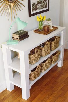 Add baskets to low shelves in a front entryway to organize everything from dog leashes to keys.
