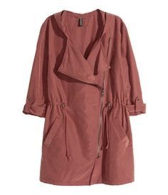 H&M: Parka with Hood. Rust. Parka in a modal blend with a soft, brushed finish. Hood, diagonal zip at front, and side pockets. Drawstring at waist and long sleeves with tab and