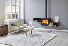 Choose your setup based on a large number of opportunities: wall hanging or placed on the floor, with different sizes of log compartments, with or without a plinth. The log compartment can be fitted with a protection glass for easier cleaning.   You can personalize your Scan 1010 to match your taste, needs and interior. This fireplace meets both aesthetic and practical needs.