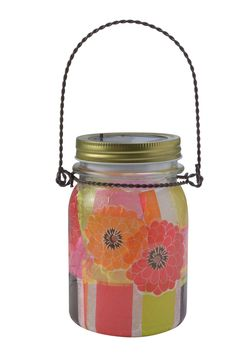 Bright and cheerful decoupage lets the light shine through, creating a soft warm glow.
