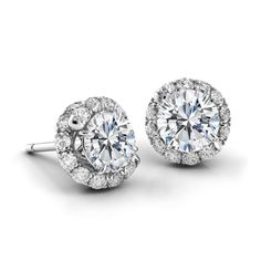 Diamond stud earrings with diamond Abbraccio swirl. Available in platinum, 14k or 18k gold (white, rose and yellow) with a .5, .75 or 1 carat center stone.