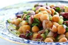 Classic American three bean salad, perfect for summer picnics and potlucks.  With cannellini beans, kidney beans, garbanzo beans, celery, red onion, parsley, and a sweet and sour dressing.