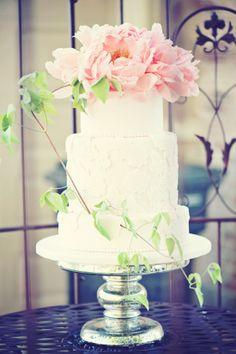 romantic white wedding cake with fresh peonies