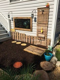 Build a playground for kids with pallets.