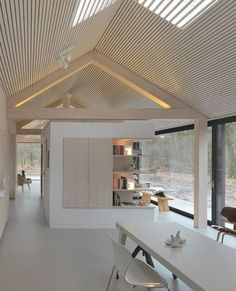 Oisterwijk The Netherlands, 2010 Interior design Modest in its appearance towards the outside, this lengthy residence has a beautiful outlook on the woodlands of the natural reserve that it stands within. The shape of the house is deceptively simple, as it mimics the archetypal form of an oblong barn, measuring 26 by 6 meters. In close…