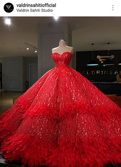 valdrin sahiti red sequin ball gown with feather