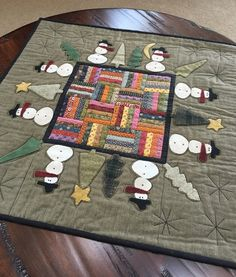 "cute winter table topper ""snowman quilt"", designed by quilts by cheri, by anne, from the cottons 'n woolens blog"