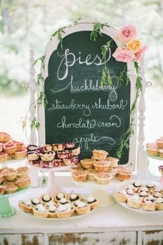 Dessert bar featuring mini pies in a variety of mouth-watering flavors. Use a chalkboard to let guests know what their options are. Pies not your dessert of choice? Use this idea with cookies, whoopie pies, or sundae toppings.