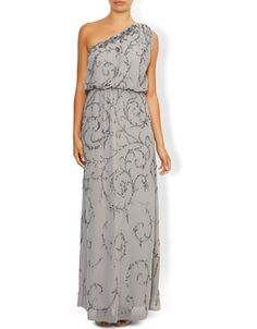 Our ethereal Ember floor-length gown is beautifully embellished with shimmering sequins and beads that sparkle as they catch the light. Lined for a smooth fit, this flattering one-shoulder style has a blouson bodice with a stretchy, defined waistband and a silhouette-defining column skirt.