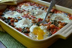Eggs Baked in Chickpea-Tomato Sauce with Baby Spinach is a wonderfully different brunch alternative to the ubiquitous strata.