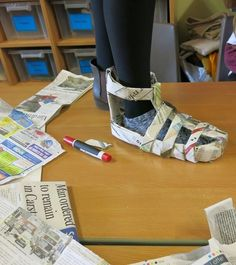 Newspaper shoe challenge - give students newspaper and tape and the possibilitie.Newspaper shoe challenge - give students newspaper and tape and the possibilities are endless. STEAM project - Old newspaper sticker Steam Activities, Science Activities, Science Experiments, Space Activities, Physical Activities, Team Bonding Activities, Physical Science, Stem Science, Teaching Science