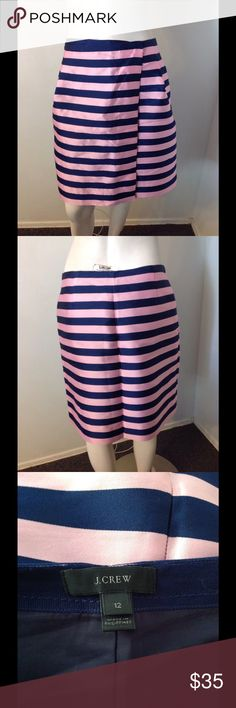"""J. Crew Pink Navy Shiny Striped Wrap Skirt 12 Very nice J. Crew skirt. Pink and navy shiny poly/silk blend. Wraps over to the side - connected on the inside and zips. Fully lined. Size 12. Great condition. Waist 33"""" Length 20 1/2"""" J. Crew Skirts"""