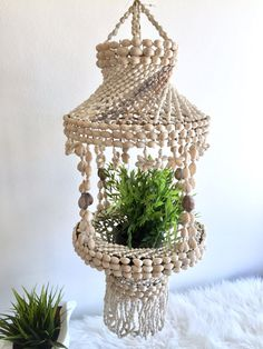 Hanging Seashell Planter / Sea Shell Chandelier / Cowrie Shell Hanging Plant Holder or Lamp Shade / Nautical Beach Cottage Bohemian Decor Gorgeous Seashell hanging planter Indoor outdoor Measures: 33 long 11 diameter at the widest  CONDITION REFERENCE CHART RATING: Excellent in excellent vintage shape, no damages to report  Thanks for looking and check out my other listings at: https://www.etsy.com/shop/RachaelsRealm?ref=hdr_shop_menu