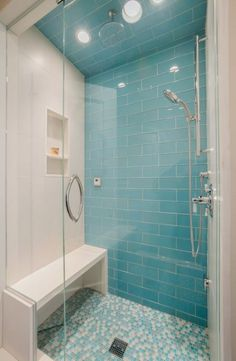 Accent in solid color tile with coordinating floor tile. This bathroom renovation was for a tween girl who loves the beach. I selected bright turquoise blue glass tile. This shower was once a tub! Wood Look Tile Bathroom, Brown Bathroom, Bathroom Colors, Small Bathroom, Bathroom Ideas, Blue Glass Tile, Glass Tiles, Bathtub Makeover, Turquoise Bathroom