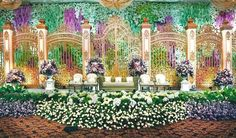 The magnificent golden gates altar for wedding decoration | Project by Suryanto Decoration http://www.bridestory.com/suryanto-decoration/projects/wedding-decoration-hotel-mulia: