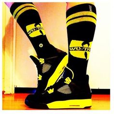 Quinn would rock these in a second...Jordan retro 4 Thunder & Wu Tang Socks