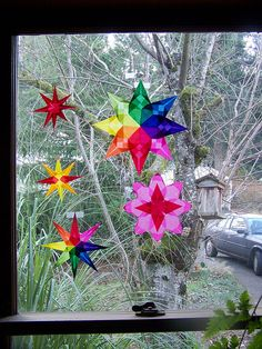 I love making these window stars out of colored vellum... They last for years :)