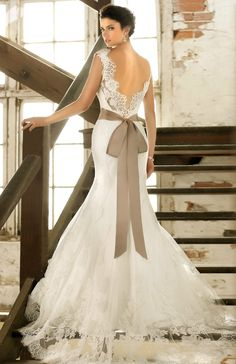 Lace wedding dress with satin belt