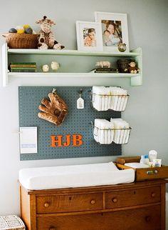 cute idea for organizing a baby boys changing station :: nursery room