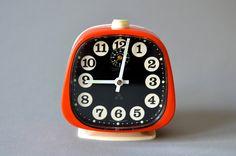 Vintage alarm clock West German black orange Peter Mid-Century 60s 70s. €32.00, via Etsy.
