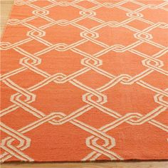 Chain Link Dhurrie: 4 Colors A large scale pattern of interlocking diamonds creates a fresh look for your traditional, modern or eclectic home. Available in 4 bold hues of Salmon Orange, Cool Aqua, Spring Green and Yellow Chiffon to bring geometric sophistication to your living room, entry or bedroom. A flat-woven dhurrie rug is reversible, for a double life, adding value to its lasting style. 100% Wool.