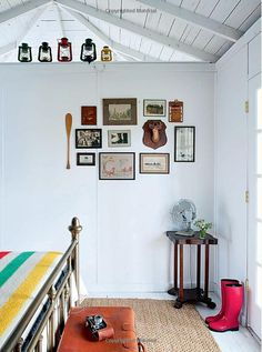 Love this room: Hudson's bay blanket, vintage fan, and the wall of goodies.