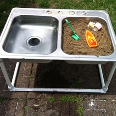 A stainless steel recycled sink, mounted on a homemade pvc pipe base,  becomes the worlds easiest backyard water and sand table. This is genius level recycling.