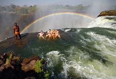 """The Place: Devil's Pool; Livingstone Island, Zambia The Reason to Go: Because watching The Amazing Race doesn't count as """"experiencing new things."""" Truly step outside your comfort zone—by stepping into the natural pool located on the edge of the 355-feet-high Victoria Falls."""