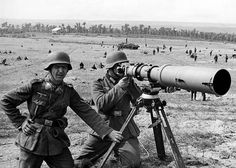 Members of the German propaganda unit 637 are watching with a telephote heavy artillery shelling of Soviet positions in the Ukraine, august 1941 - pin by Paolo Marzioli