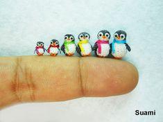 Miniaturas de animais feitas em crochê, pela empresa vietnamita SuAmi - Familia de Pinguins em crochê