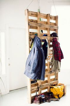Pallet Coat Storage :: pallets suspended from the ceiling to create a coat storage and room divider.I might like something like this in the garage. by annabelle Metal Room Divider, Bamboo Room Divider, Bed Divider, Attic Renovation, Attic Remodel, Coat Storage, Attic Storage, Garage Storage, Wire Storage