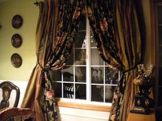 formal dining room drapes. Outside ones score at thrift store . Inside floral I made.