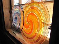 We use a local artisan for our hand blown Stained Glass Roundels. http://jamaicacottageshop.com/shop/stained-glass-roundel-window/