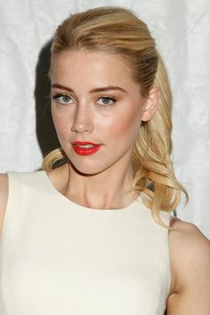 Amber Heard looks completely gorgeous with her golden blonde locks swept into a high pony.