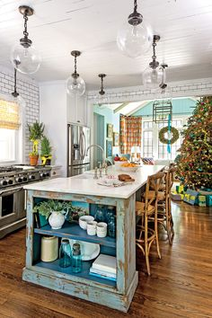 Island Time - Our Favorite Christmas Kitchens - Southernliving. When the kitchen opens into your family room, it's important for the decor to carry through. Here, the kitchens colors worked their way into the decorations like the blue and red wreath and Christmas Kitchen Decor, Retro Home Decor, Kitchen Remodel, Kitchen Decor, Rustic Kitchen Island, Kitchen Island Design, Home Kitchens, Rustic Kitchen, Kitchen Renovation