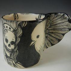 Pam Stern. Black and white porcelain bird cup with skeletons. Porcelain, underglaze, glaze.